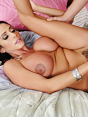 Busty MILF Ariella Ferrera wakes up younger guy and punished him by making him fuck her pussy.