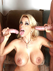Holly Halston fucks two younger guys and loves sucking and being fucked at the same time.