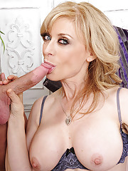 Nina Hartley is fucked by a younger guy and she loves riding his cock on the couch.