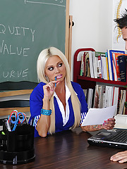 Nikita Von James decides to get saucy and fuck on her teacher desk.