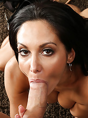 Ava Addams seduces younger guy by changing into a sexy outfit and fucking the guy on the couch.