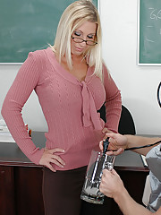 Devon Lee has hot sex with one of her student son her desk.