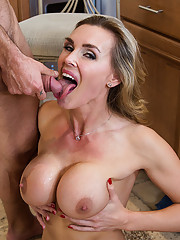 Busty blonde cougar fucks worker in the kitchen.