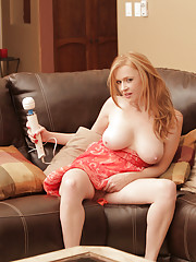 Anilos redhead stimulates her throbbing clit with a magic wand