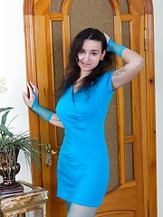 In blue, Ramira strips in stockings and gets naked