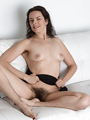 Erotic Lucia strips from black dress to play naked