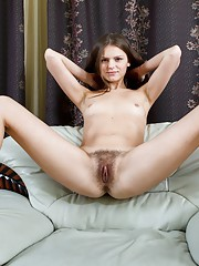 Elena May is a hairy woman on a chair