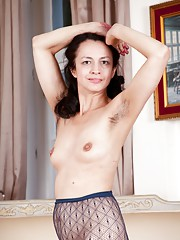 Tracey Anne strips from stockings to masturbate