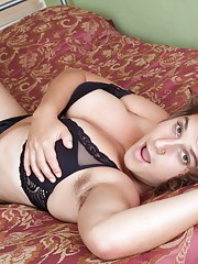 Sayge strips in bed from lingerie to naked