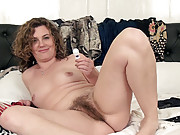 Sofia Matthews plays with vibrator on bed