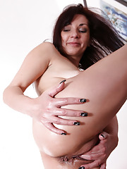 Tyna Black spreads her legs wide for a deep finger fuck