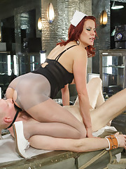 Maitresse milks slaves cock while immobile in a vacu bed and denies him her pussy while he