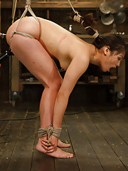 Gorgeous Island Babe in tight inverted suspensions, vicious back bends, intense flogging, predicament bondage, pussy penetration, intense orgasms