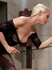 Sexy leather clad blonde dominatrix teases, denies and pegs new slave in chastity.