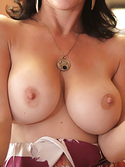 Sexy mommy with big soft boobs rubs her swollen clit