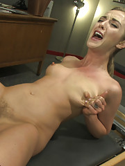 Sexy, toned blond with athlete build and tight pussy gets fucked by machines until she squirts all over the coach