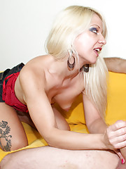 Sexy Caroline jerking off huge cock of a horny guy
