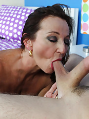 Busty MILF Ciara sucking huge young cock