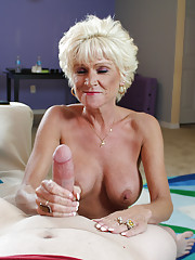 Mature mom Nikki stroking big cock and get loads of cum