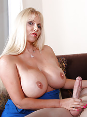 Busty milf jacking off the big package of the deliver boy