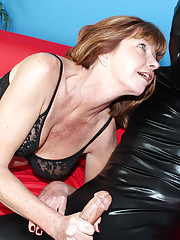 Naughty milf Dee jacking off a man all wrapped up