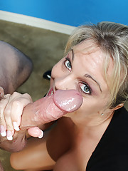 Busty Milf Amber jerk off big cock and get loads of jizz on her face
