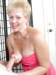 Busty milf Tracy get cumshot on her face and tits