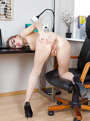 Steamy hot secretary fingers her cum hungry pussy at her desk
