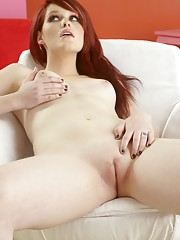 Red haired beauty undresses