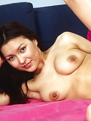 Asian with a purple dildo