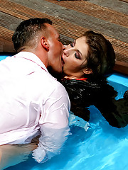 Couple jumping in the pool