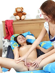 Daring girls sharing a bed