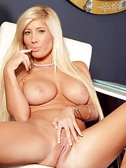 Babe with long hair fondles