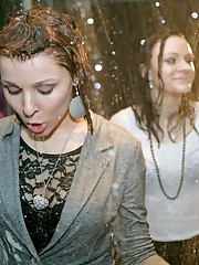 Girls kiss at a wet party