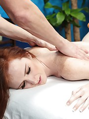 Cute redhead Dee Dee is seduced and fucked hard by her massage therapist