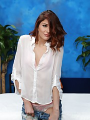 Sexy redhead Ashlyn is seduced and fucked hard by her massage therapist