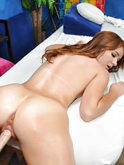 Sexy redhead Ava is seduced and fucked hard by her massage therapist