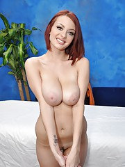 Sexy redhead Jessica is seduced and fucked hard by her massage therapist