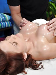 Cute redhead Kenzie is seduced and fucked hard by her massage therapist
