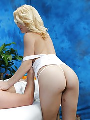 Sexy blonde massage therapist Courtney gives a little more than a massage!