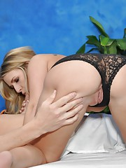 Sexy blonde massage therapist Rachel gives a little more than a massage!