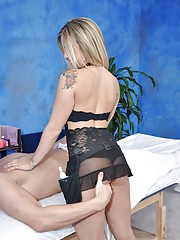Sexy blond in lingerie gives the best massage and a little extra!