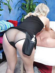 Cute 18 year old blond massage therapist Natalie gives a little more than a massage!