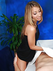 Sexy blonde/brunnette gives a massage and a sexy surprise ending!