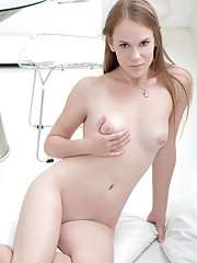 Fresh faced girl next door pleases her pussy by stuffing it with her fingers