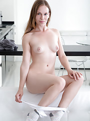 Naughty Nubile with puffy pink nipples teases her clean shaved pussy