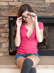 Sexy Nubile in glasses spreads open her soft pink pussy