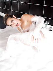 Wild college hottie with a juicy ass gets down and dirty in a bubble bath
