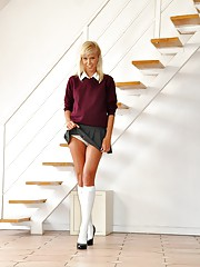 Blonde schoolgirl undresses