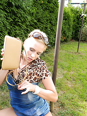 Blonde pissing in her purse